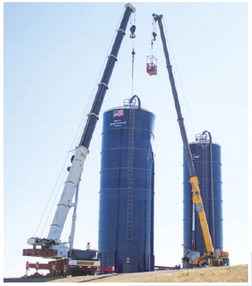 Peerless Silo  Begrudgingly  Comes Down