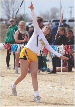 EMMIE FISHELL, a Scobey freshman, lets the javelin fly during the season-opening Glasgow Invitational